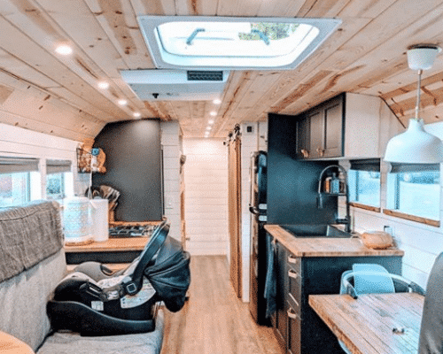 Black and Wood Tiny House Bus