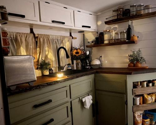 wander with us skoolie kitchen